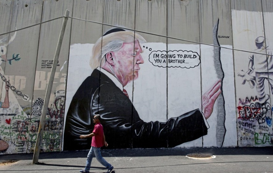 Possible new Banksy graffiti, depicting Trump, surfaces on West Bank barrier