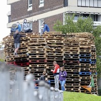 Bonfire rebuilt near blocks of flats in north Belfast