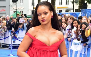Rihanna impresses with sparkling bikini and feathers for festival