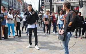 Liam Payne surprises fans by busking in Oxford Circus