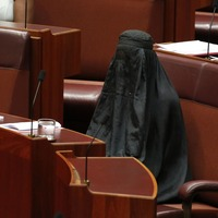 An Australian senator wore a burka into the chamber as she argued for it to be banned