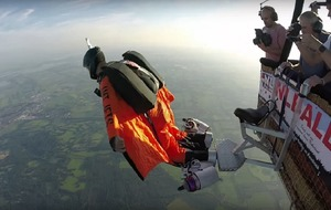 Watch a stunt man test out his jet-powered wing suit for the first time
