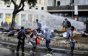 Asylum-seekers clash with police over moves to evict them from a Rome piazza
