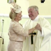 Video: Priest, bride, groom and guests dance in church aisle