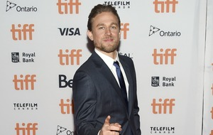 Charlie Hunnam says he shuns 'rigged game' of private prison investments