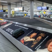 You won't get bored waiting for luggage at Schipol airport due to its carousel art gallery