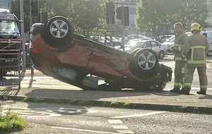 Car lands on roof after Belfast collision
