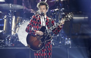 Harry Styles divides fans with bright and bold suit for solo performance