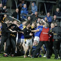 Gaelic football supporters take to pitch in post-match brawl