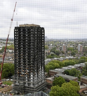 Work starts to cover Grenfell Tower ruins