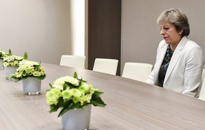 Forget fields of wheat, Theresa May sitting alone at a table is the meme of the moment