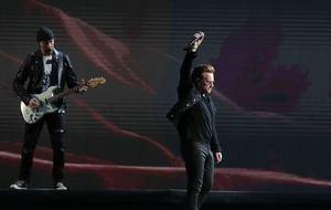 U2 call on Burma's Aung San Suu Kyi to fight harder against national violence