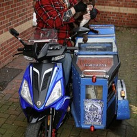 West Belfast pensioner turning heads with new scooter side car...for his dog