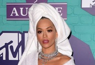 Rita Ora walks the EMAs red carpet in a dressing gown