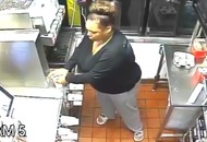 Police hunt McDonald's thief who climbed through the drive-thru window and made herself a drink