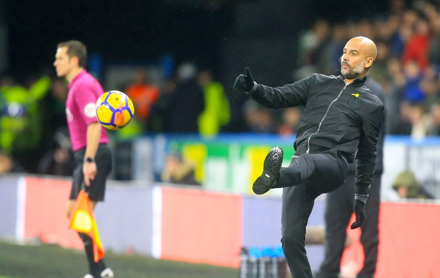 Manchester City defeat Huddersfield, set record