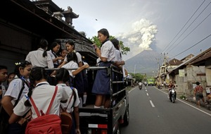 Bali volcano with deadly history spits ash more than two miles high