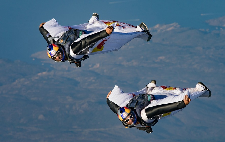 Watch daredevil wingsuit flyers land inside a moving plane in mid-air