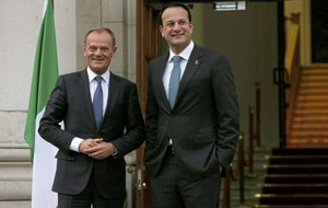 European Council president Donald Tusk warns Theresa May she must satisfy Irish demands of no hard border
