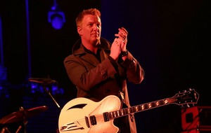 Queens of the Stone Age frontman Josh Homme apologises as photographer 'kicked'