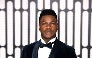 Star Wars actor John Boyega beams as his parents join him at film premiere