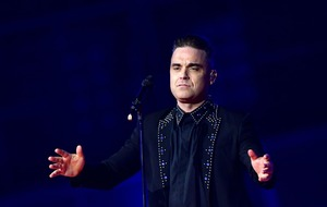 Robbie Williams tells of 'very scary' week spent in intensive care