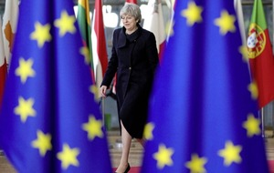 May says she remains on course to deliver on Brexit despite her humiliating Commons