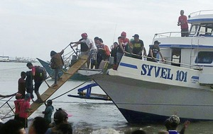 Ferry capsizes in stormy seas off Philippines' coast