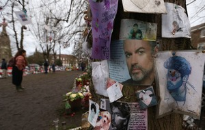 Tributes left at George Michael's homes on first anniversary of his death