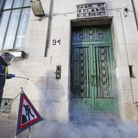 Young offenders scrub buildings clean of graffiti in Belfast city centre