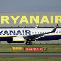 Ryanair passenger forced way out of emergency exit and onto wing of plane