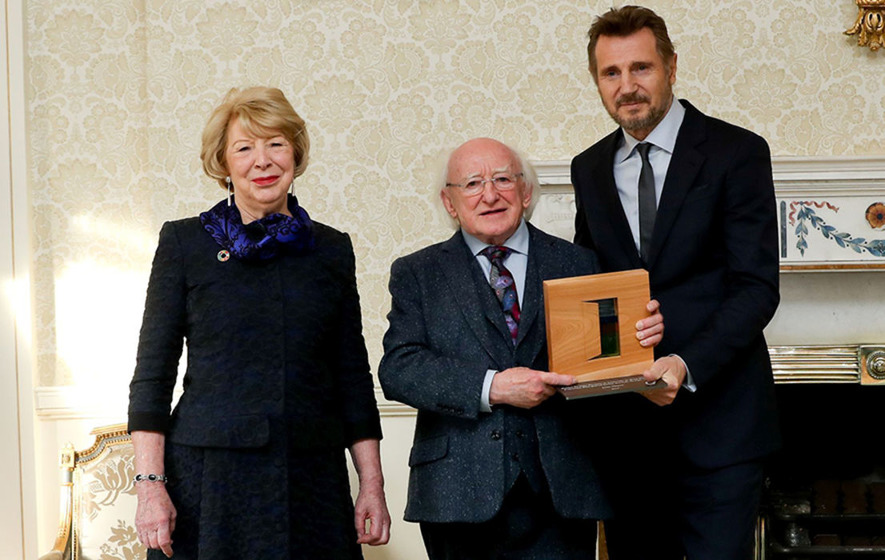President Higgins presents Liam Neeson with Distinguished Service Award