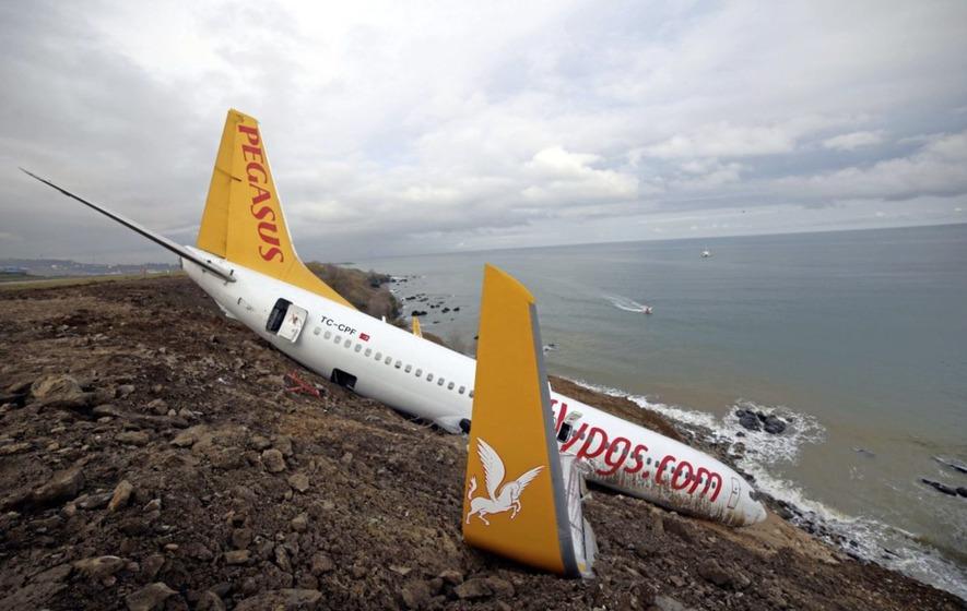 Turkish jet dangles precariously off muddy cliff following crash landing