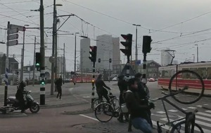 Watch as strong winds in Europe tear this cyclist's bike out of their grasp