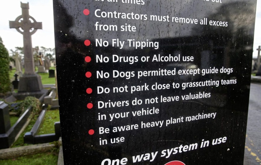 Signage erected at Milltown Cemetery informing visitors that dogs are no longer permitted in the grounds