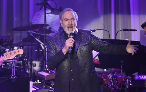 Neil Diamond retires from touring and cancels shows after Parkinson's diagnosis