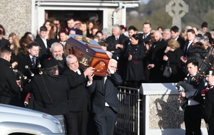 Applause as O'Riordan coffin is carried out of church to Cranberries song