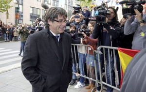 Fugitive former Catalan president Carles Puigdemont denies giving up for re-election fight