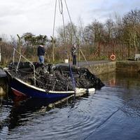 Three men assaulted at patrol boat arson site