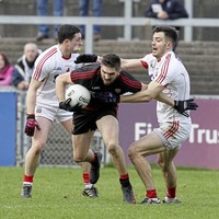 Cork cash in on a bad day at the office for Down