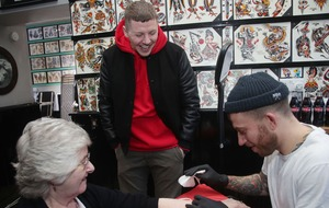 Professor Green takes aim at the Government as his nan gets a temporary tattoo