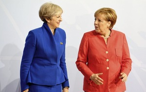 Angela Merkel 'curious' about the UK's approach to Brexit as she holds talks with Theresa May.