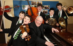 St Malachy's past pupils head back to school to play alongside inspirational teacher who formed first Orchestra