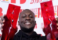 Stormzy raps about Theresa May and 'money for Grenfell' at Brit Awards