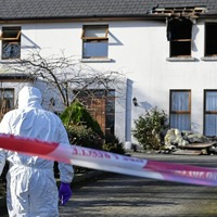 Man charged with attempted murder after woman tied up and house set on fire during Co Down burglary