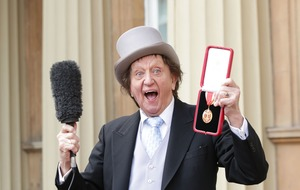Sir Ken Dodd leaving hospital after recovering from chest infection