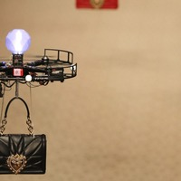Drones fly down the catwalk carrying Dolce & Gabbana handbags