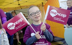 Matthew's cheering on his mum and MenCap in Belfast City Marathon
