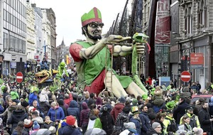Revellers brave the `Mini Beast' to celebrate St Patrick in towns and cities around Ireland