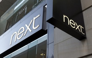 Next profits slide after high street sales slump